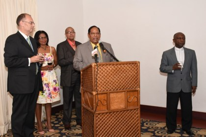 Prime Minister Moses Nagamootoo delivering brief remarks at the reception following the accreditation of the Danish Ambassador. The ambassador is to the left. Also in photo is Foreign Affairs Minister Carl Greenidge