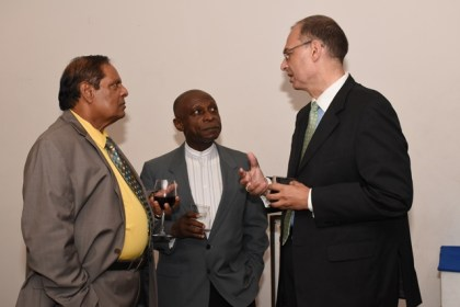 Prime Minister Moses Nagamootoo, Minister of Foreign Affairs, Carl Greenidge and Danish Ambassador Kim Højlund Christensen in conversation  at the reception following the Ambassador's accreditation