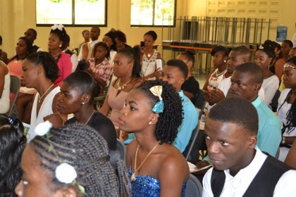 The graduates pay keen attention as the First Lady makes her address.