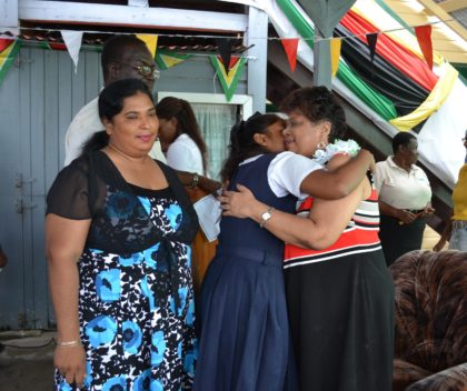 Minister of Social Cohesion, Ms. Amna Ally receives a warm welcome from a student at the presentation exercise hosted in the compound of the Department of Education, East Berbice-Corentyne