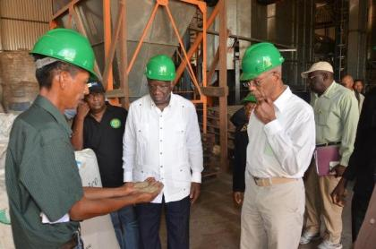Assistant Farm Manager, Mr. Christopher Moses showing President David Granger and Barbados Prime Minister Freundel Stuart the quality of rice produced at the Santa Fe rice mill