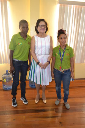 First Lady, Mrs. Sandra Granger is flanked by, from left, Ms. Collet Hope and Ms. Carrin Carter, both representatives of the Guyana Rugby/Football Union
