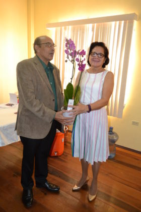 Mr. K.A. Juman-Yassin presents First Lady, Mrs. Sandra Granger with an orchid in appreciation for her attendance at the GOA's Women in sport Seminar, this morning