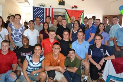 First Lady, Mrs. Sandra Granger poses with the United States Army cadets, who taught leadership and others skills at the Lusignan-Good Hope Learning Centre. United States Ambassador to Guyana, His Excellency Perry Holloway is pictured in the back row, to the left of Mrs. Granger.