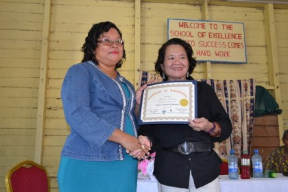 Ms. Suzette Sewram and First Lady, Mrs. Sandra Granger, during the graduation ceremony of the Self-Reliance and Success in Business Workshop