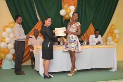 Ms. Adeti DeJesus, of the Office of the Presidential Advisor on Youth Empowerment presents a certificate to Akeila Dey