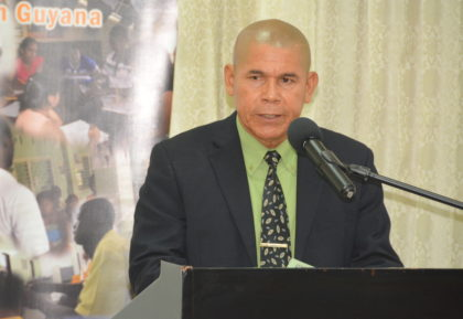 Minister of Public Health, Dr. George Norton, during his remarks at the World Population Day Symposium