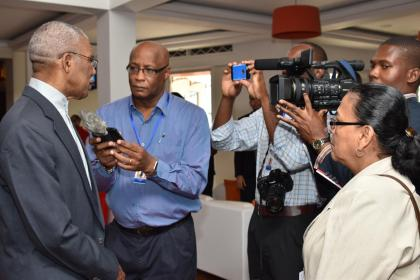 President David Granger speaking with media operatives, earlier today, at the Thirty Seventh Regular Meeting of the Conference of the Heads of Government of the Caribbean Community at the Pegasus. (GINA photo)