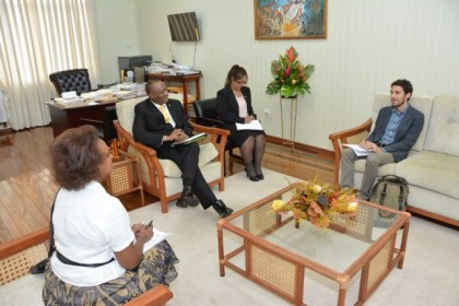 Minister of State, Mr. Joseph Harmon, in discussion with Mr. Fabio Oliva and Ms. Khadija Musa, during their meeting at the Ministry of the Presidency, earlier today