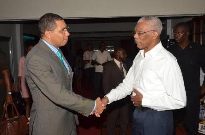 President David Granger and Prime Minister Andrew Holness greeting each other a the Pegasus Hotel this afternoon just before they sat down for bilateral talks.
