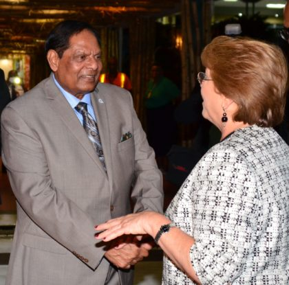 Prime Minister Moses Nagamootoo greets Chilean President Michelle Bachelet at the CJIA