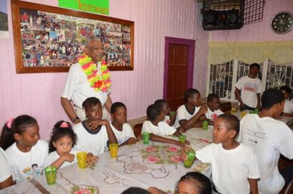 President David Granger and some of the children of the Hope Children's Home at the book presentation held there, this morning, in honour of his 71st birthday