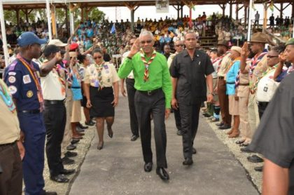 President Granger acknowledges the salute by the Scouts of the 14 participating countries, as they welcome him to the opening ceremony of the 14th Caribbean Cuboree, which is being held in Guyana.