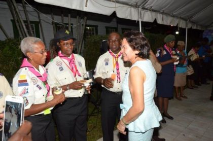 First Lady, Mrs. Sandra Granger, seems to have captured the attention and admiration of this group of Scouts at the reception held in their honour at the President's residence.