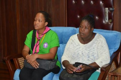 Mothers of the two injured Cub Scouts (left) Ms. Jacqueline Matthew and (right) Ms. Delia Finistere listen intently to President David Granger, during the meeting this morning.