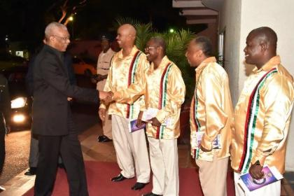 His Excellency, President David Granger is welcomed to the event by the quartets, upon his arrival at the venue, last evening
