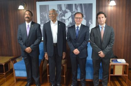 President David Granger interacting with Secretary General of Hague Conference on Private International Law, Dr. Christophe Bernasconi and Attorney General and Minister of Legal Affairs Basil Williams and HCCH's Latin America's Representative Ignacio Goicoechea before talks on the upcoming Hague Convention Conference