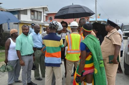 (Centre) Minister within the Ministry of Public Infrastructure, Annette Ferguson listening to the concerns of Sophia residents