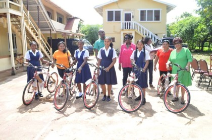Students receive bicycles in Region 9 as part of the President's Five Bs initiative
