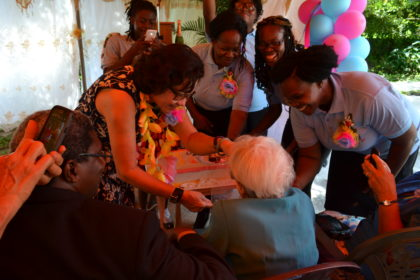 First Lady, Mrs. Sandra Granger gives Ms. Myrtle Fleming a piece of her birthday cake as care-givers at the Millicent Greaves Memorial Residence look on.  Ms. Fleming is celebrating her 95th birthday today