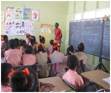 GLSC-Staff-Ms.-Oleta-Williams-speaking-to-the-children-on-the-importance-of-protecting-the-land