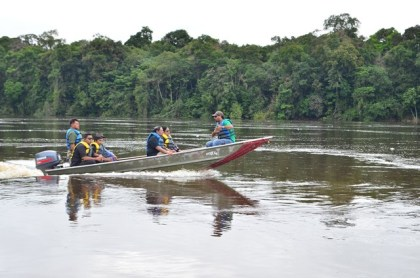 Prime Minister Moses Nagamootoo and VP Sydney Allicock and team on a survey trip on the Essequibo river in the vicinity of the Kurupukari crossing.