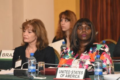 Valerie Barlow, US Representative at the Office of Children's Issues, US State Department (right)