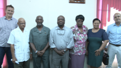 Minister in the Ministry of Social Protection with responsibilities for Labour Keith Scott meeting in discussion with representatives of Bauxite Company of Guyana Incorporated (BCGI) at his office this morning.