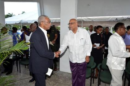 President Granger greeting Dr. Richard Van West Charles, the son-in-law of the late Forbes Burnham