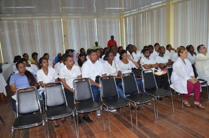 Cuban Trained sixth year medical students being debriefed by Permanent Secretary of the Department of Public Service, Reginald Brotherson during the orientation session.