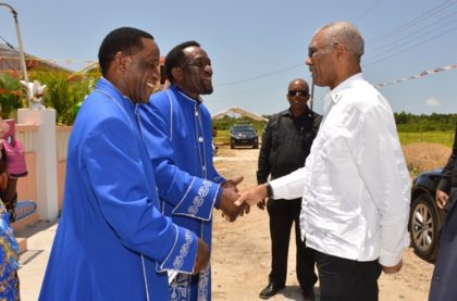President David Granger being greeted by Pastors Ewart and Egbert Bagot upon his arrival at the Solomon's Temple at Phillipi Village