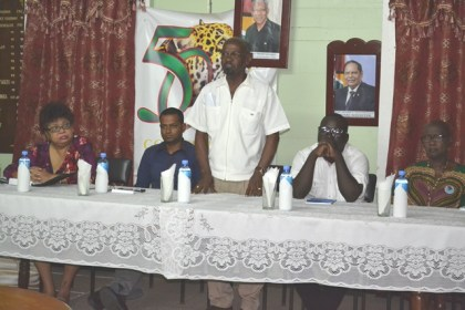 Minister of Social Cohesion, Ms. Amna Ally, Regional Chairman, Mr. Vickchand Ramphal, Regional Vice-Chairman, Mr. Rion Peters and Ms. Jennifer Wade, Member of Parliament, listen as Regional Executive Officer, Mr. Ovid Morrison makes a point.