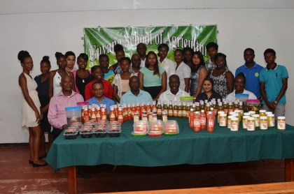 Presidential Advisor on Youth Empowerment Aubrey Norton (third from left sitting), Permanent Secretary to the Ministry of Agriculture George Jervis (third from right), Dr. Dindyal Permaul, Principal, Guyana School of Agriculture (GSA) (second from left) along with officials from the GSA and the graduating class of the Agro-Processing Training Programme