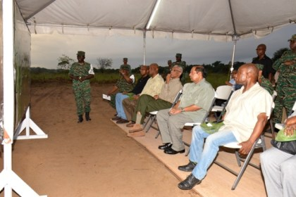 President David Granger pays keen attention as Deputy Chief of Staff of the Guyana Defence Force, Colonel George Lewis, explains the elements of Exercise 'HOMEGUARD'. Prime Minister Moses Nagamootoo, Minister of Foreign Affairs, Mr. Carl Greenidge and Minister of State, Mr. Joseph Harmon also look on.