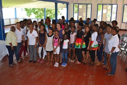 """Mrs Granger poses with members of the Guyana Girl Guides Association and graduates of the """"Be Your Best You"""" programme."""