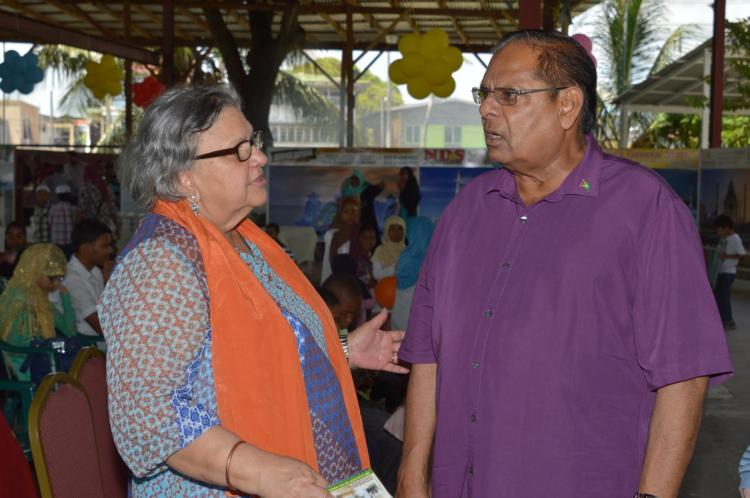 Prime Minister Moses Nagamootoo in conversation with Former Social Security Minister and executive member Bibi Shadick at CIOG