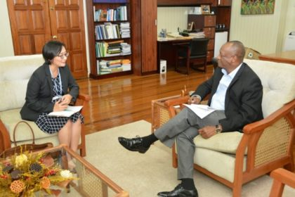 Minister of State, Mr. Joseph Harmon engaging the new United Nations Development Programme (UNDP) Resident Representative in Guyana, Ms. Mikiko Tanaka at the Ministry of the Presidency, earlier this afternoon.