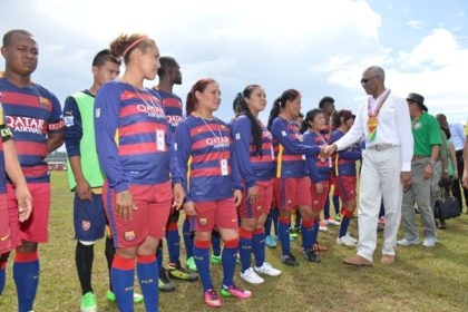 President David Granger greets members of the Waramadong male and female footbal teams before the beginning of the first fixture in the competition.