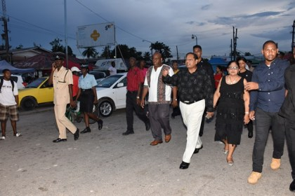 Prime Minister Moses Nagamootoo, Mrs. Sita Nagamootoo, and Regional Member of Parliament, Audwin Rutherford during the walkabout at the McKenzie Market square