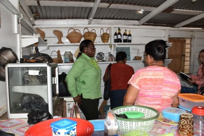 Minister in the Ministry of Natural Resources, Simona Broomes meeting with the women's group of Moruca, Region One in their craft shop