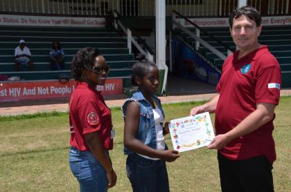One of the children receiving her certificate of participation