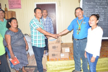 Minister of Indigenous Peoples' Affairs, Sydney Allicock presenting medical supplies to Kwebanna, Region One, Toshao, Paul Pierre, to aid in the health sector delivery