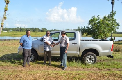Minister of Indigenous Peoples Affairs', Sydney Allicock presenting to the Regional Executive Officer (REO), Region One, Leslie Wilburg, a vehicle to aid in the delivery of  services at the Moruca Hospital
