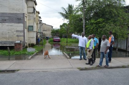 Community Coordinator, Ministry of Public Infrastructure Neilson McKenzie along with officials from the Ministry of Communities and Mayor and City Council assessing the flood affected community of Wortmanville.