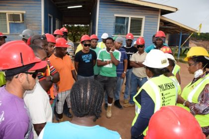 Bauxite workers in discussion with Minister within the Ministry of Natural Resources Simona Broomes