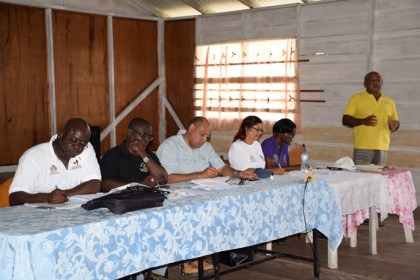 Minister of Natural Resources, Raphael Trotman and team including Permanent Secretary of the Ministry of Communities, Emilie McGarrel at the meeting in Imbaimadai, Region Seven
