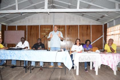 Minister of Natural Resources Raphael Trotman makes a point during a meeting with miners and residents in Imbaimadai, Region Seven