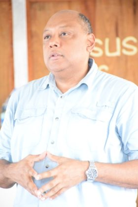Minister of Natural Resources Raphael Trotman addressing concerns of indigenous residents and coastlanders in Imbaimadai, Region Seven