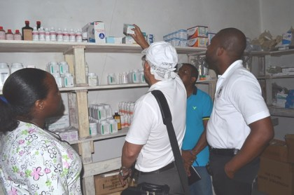 Minister of Public Health, Dr. George Norton inspecting a pharmacy during a recent visit to the Wakenaam Cottage Hospital