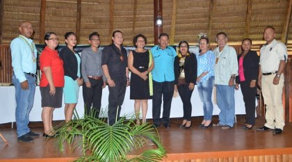 Minister of Indigenous Peoples' Affairs, Sydney Allicock and Minister within the Ministry, Valerie Garrido Lowe (center), along with members of the Indigenous Affairs Month Organising Committee pose for a group photo